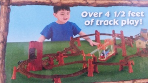 See the kid on the box? If you look closely, you'll see he's not really smiling. He's gritting his teeth with rage and is reaching out to grab and throw Thomas across the room.